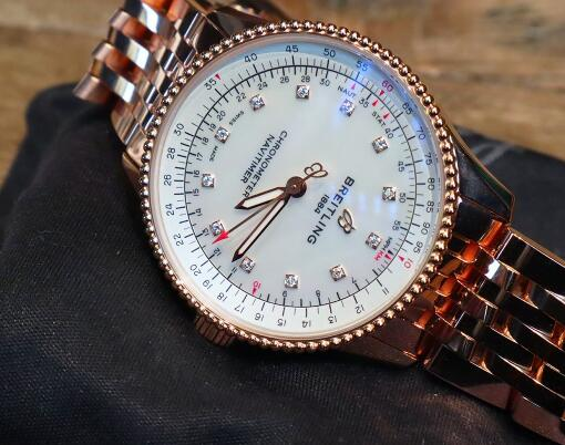 The mother of pearl dial and diamonds hour markers add the feminine touch to the model.