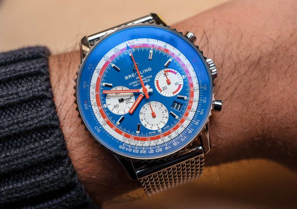 The red elements are striking contrasted to the blue dial of copy Breitling.