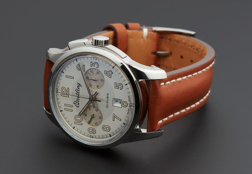 The silvery dial fake watch has Arabic numerals.